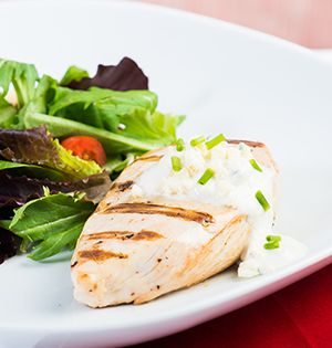 Grilled Chicken Breasts with Blue Cheese Sauce